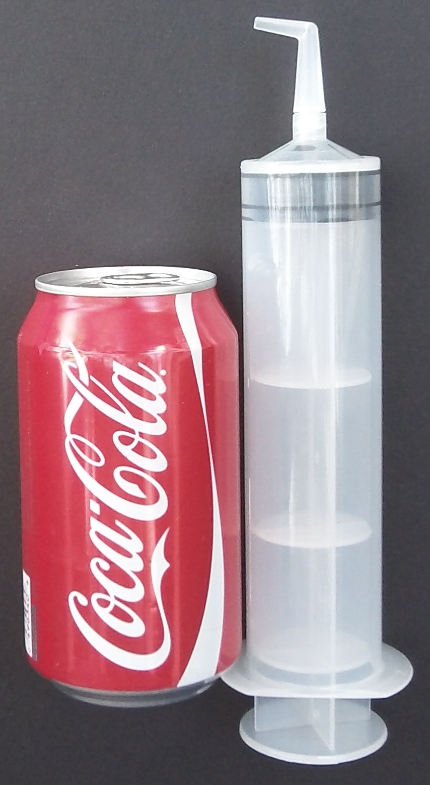 Size comparison of Ear-Clear next to 12 fl. oz. soda can.